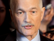 NDP leader Jack Layton speaks with the media in the foyer of the House of Commons following the federal budget on Parliament Hill in Ottawa on Tuesday March 22, 2011. (THE CANADIAN PRESS/Fred Chartrand)