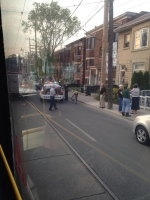 A police vehicle is pictured on Ossington Avenue just north of Dundas Street following a shooting Sunday May 19, 2013. (@danieliswhite/ Twitter)