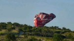 This image from video provided by E. Wayne Ross shows an Anatolian Balloons Company hot air balloon crashing near Göreme National Park and the Rock Sites of Cappadocia in central Turkey, Monday, May 20, 2013. (AP Photo/E. Wayne Ross)
