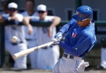 Toronto Blue Jays player Anthony Gose breaks his bat as he singles during the seventh inning of a spring training baseball game against the Detroit Tigers in Lakeland, Fla., on Friday, March 15, 2013. (AP Photo/Carlos Osorio)