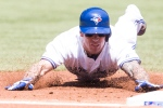 Toronto Blue Jays Brett Lawrie slides safely into third after hitting an RBI triple off Tampa Bay Rays pitcher Jake Odorizzi during first inning AL baseball action in Toronto on Monday, May 20, 2013. (The Canadian Press/Chris Young)