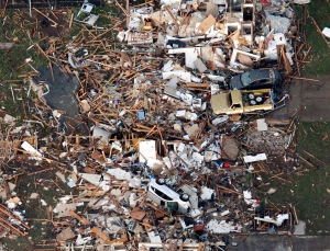 This aerial photo shows the remains of houses in Moore, Okla., following a tornado on Monday, May 20, 2013. (AP Photo/Steve Gooch)