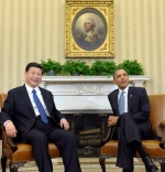 In this file photo taken Tuesday, Feb. 14, 2012, Chinese Vice President Xi Jinping, left, meets with President Barack Obama in the Oval Office of the White House in Washington. (AP Photo/Susan Walsh, File)