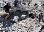 This citizen journalism image provided by Qusair Lens, which has been authenticated based on its contents and other AP reporting, shows Syrian citizens inspecting the rubble of buildings that were damaged from a Syrian forces airstrike in the town of Qusair, Syria on Tuesday, May 21, 2013. (AP Photo/Qusair Lens)