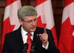 Prime Minister Stephen Harper speaks to his caucus on Parliament Hill in Ottawa on Tuesday, May 21, 2013. (The Canadian Press/Fred Chartrand)
