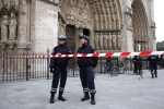 Police officers stand guard in front of Notre Dame Cathedral in Paris on Tuesday, May 21, 2013. (AP Photo/Thibault Camus)