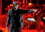 In an April 15, 2012 photo, Eminem performs onstage at the 2012 Coachella Valley Music and Arts Festival in Indio, Calif. (AP Photo/Chris Pizzello)