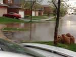 A flooded street in Orangeville is pictured after a severe thunderstorm Tuesday, May 21, 2013. (@redd_ddiva/Twitter)