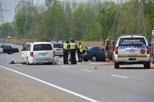 Police and emergency crews are visible at the scene of a fatal multi-vehicle crash on Highway 6 in Hamilton on Tuesday, May 21, 2013. (CP24/Andrew Collins)