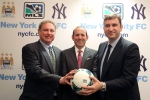 New York Yankees president Randy Levine, left, Major League Soccer Commissioner Don Garber, center, and Manchester City CEO Ferran Soriano pose for a photo at the MLS headquarter in New York on Tuesday, May 21, 2013. (AP Photo/Mary Altaffer)