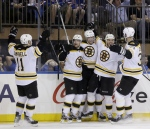 Boston Bruins' Daniel Paille, second from left, celebrates his game-winning goal with teammates Gregory Campbell, left, Dougie Hamilton, center, Shawn Thornton, second from right, and Zdeno Chara during the third period in Game 3 of the Eastern Conference semifinals against the New York Rangers on Tuesday, May 21, 2013, in New York. (AP Photo/Seth Wenig)