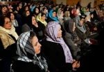 Afghan women listen to Afghan President Hamid Karzai, during a speech about women's rights, in Kabul, Afghanistan on Wednesday, Nov. 24, 2010. (AP Photo/Musadeq Sadeq)