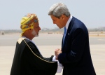 U.S. Secretary of State John Kerry, right, is greeted by Oman Foreign Minister Yusuf Bin Alawi bin Abdullah in Muscat, Oman, Tuesday, May 21, 2013. (AP Photo/Jim Young, Pool)