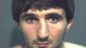 Ibragim Todashev is shown in a handout photo provided by the FBI. The FBI says Todashev was fatally shot when he initiated a violent confrontation during questioning connected to the Boston Marathon bombing probe. (Handout/FBI)