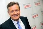 "This May 7, 2013 file photo shows Piers Morgan at the Brady Campaign to Prevent Gun Violence Los Angeles Gala in Beverly Hills, Calif. "" Morgan has a deal with Gallery Books for ""Shooting Straight: Guns, Gays, God, and George Clooney."" Gallery, an imprint of Simon & Schuster, announced Wednesday, May 22, that the book is scheduled for October. (Photo by Chris Pizzello/Invision/AP, file)"
