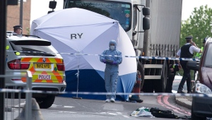 A tent is erected near the scene of an attack in Woolwich in southeast London on Wednesday, May, 22, 2013. (AP Photo/Alastair Grant)