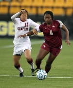 Stanford's Rachel Quon, left, and Florida State's Jamia Fields fight for possession of the ball in the first half of their NCAA Women's College Cup final four soccer match Friday, Dec. 2, 2011, at the Kennesaw State Soccer Stadium in Kennesaw, Ga. (The Canadian Press/AP Photo/Atlanta Journal & Constitution, Jason Getz)