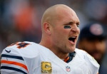 In this Nov. 4, 2012 file photo, Chicago Bears middle linebacker Brian Urlacher yells while watching from the bench in the fourth quarter of an NFL game against the Tennessee Titans in Nashville, Tenn. (AP Photo/Joe Howell, File)