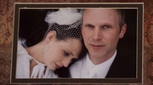A photograph of widow Sharlene Bosma and her late husband Tim Bosma at a memorial in Hamilton, Ont., Wednesday, May 22, 2013, for her husband Tim Bosma, the Hamilton, Ont., man found dead after he took two men on a test drive. (Nathan Denette/The Canadian Press)