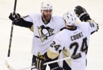 Pittsburgh Penguins forward Matt Cooke congratulates teammate Pascal Dupuis on his goal against the Ottawa Senators during third period NHL playoff action in Ottawa on Wednesday, May 22, 2013. (The Canadian Press/Adrian Wyld)