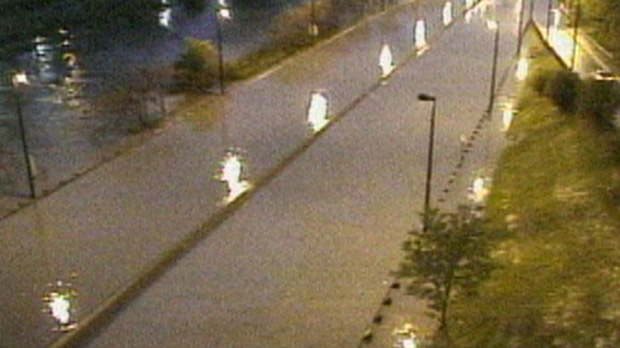 Water is seen on a flooded Don Valley Parkway early Wednesday morning. The highway has been closed south of Bloor Street as a result.