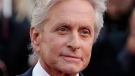 Actor Michael Douglas poses for photographers as he arrives for the screening of Behind the Candelabra at the 66th international film festival, in Cannes, southern France, May 21, 2013. (AP / David Azia)