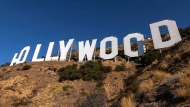 Painting crews set up on the base of the Hollywood Sign in Los Angeles Tuesday, Oct. 2, 2012. (AP / Damian Dovarganes)