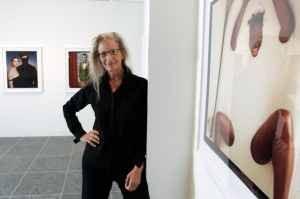 Annie Leibovitz stands near some of her work before the opening of her exhibition at the Wexner Center for the Arts Friday, Sept. 21, 2012, in Columbus, Ohio. (AP / Jay LaPrete)