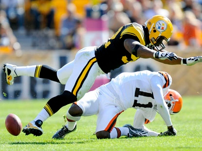 In this Oct. 17, 2010, file photo, Pittsburgh Steelers linebacker James Harrison) hits Cleveland Browns wide receiver Mohamed Massaquoi during the second quarter of a an NFL football game in Pittsburgh. (AP Photo/Don Wright, File)
