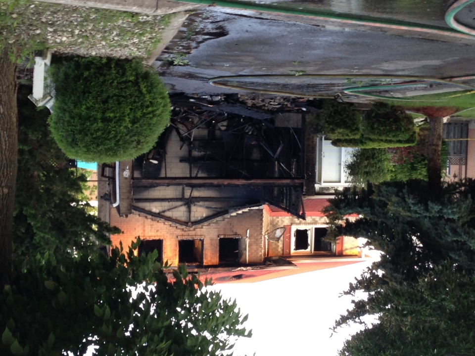 A house destroyed by fire on Houseman Crescent in Richmond Hill is seen on Tuesday, June 18, 2013. (CP24/Jackie Crandles)