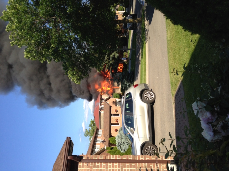 A fire at a house on Houseman Crescent in Richmond Hill is scene in this photo on Tuesday, June 18, 2013. (Jamie McCarthy)