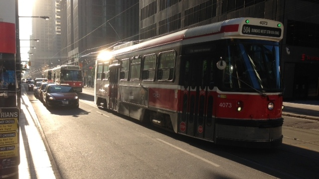 TTC streetcars and vehicles make their way along King Street West in downtown Toronto on Thursday, June 20, 2013. (Cam Woolley/CP24)