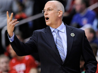 Toronto Raptors coach Jay Triano calling out a play in the second half of an NBA basketball game, Friday, April 8, 2011, in Philadelphia. (AP Photo/Michael Perez)
