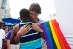 Justin Trudeau greets a supporter at the Church on Church Street service before Toronto's Pride Parade on Sunday, June 30, 2013. (THE CANADIAN PRESS/Michelle Siu)