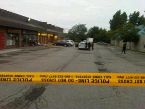 Police tape surrounds a restaurant parking lot near Sheppard Avenue East and Brimley Road after a man was stabbed Friday, July 5, 2013. (Cam Woolley/CP24)