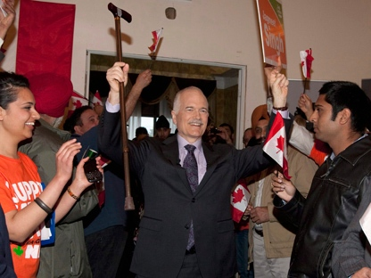 NDP Leader Jack Layton raises his arms as he enters a rally Thursday, April 21, 2011 in Brampton Ont. (THE CANADIAN PRESS/Jacques Boissinot)
