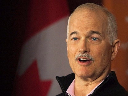 NDP leader Jack Layton talks with reporters during a campaign stop in Saint John, N.B., on Monday, April 25, 2011. The federal election will be held on May 2. (THE CANADIAN PRESS/Andrew Vaughan)
