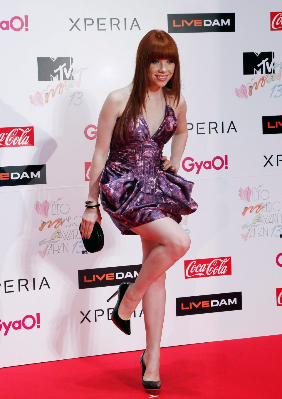 Canadian singer Carly Rae Jepsen poses for photographers upon arrival for the MTV Video Music Awards Japan show in Makuhari on Saturday, June 22, 2013. (AP Photo/Koji Sasahara)