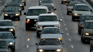 File photo: Commuters sit in rush hour traffic on the Don Valley Parkway in Toronto Monday, February 10, 2003. (Kevin Frayer / THE CANADIAN PRESS)