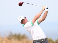 Johnson seizes early lead on calm day British Open
