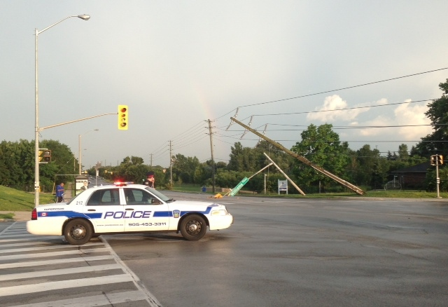 Toppled hydro poles are seen in this photograph taken at McLaughlin Road and Williams Parkway in Brampton on Friday, July 19, 2013. (CP24/Cristina Tenaglia)