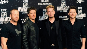 In this photo provided by the Las Vegas News Bureau, members of the rock band Nickelback pose for a photo during the NHL Awards, Wednesday, June 20, 2012, Las Vegas News Bureau, Darrin Bush)