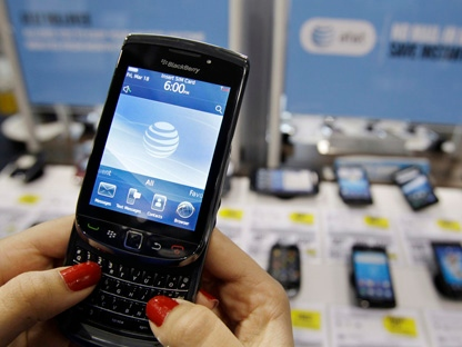 In this March 22, 2011 photo, a customer uses a Research In Motion Blackberry Torch. (AP Photo/Paul Sakuma)