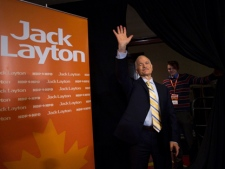 Jack Layton, left, NDP leader and now officially the leader of the opposition, waves to the media after a press conference in Toronto on Tuesday, May 3, 2011. (THE CANADIAN PRESS/Nathan Denette)