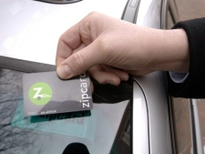 Scott Griffith, CEO of Zipcar Inc., based in Cambridge, Mass., holds one of the electronic cards that customers swipe over a sensor behind the windshield to unlock the vehicles they have reserved in this 2007 file photo. (AP Photo/Josh Reynolds, file)