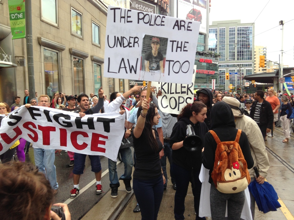 FILE - Protesters march along Dundas Street in a demonstration being held to condemn the actions of police in the shooting death of Sammy Yatim. (Brian Carr/CP24.com)