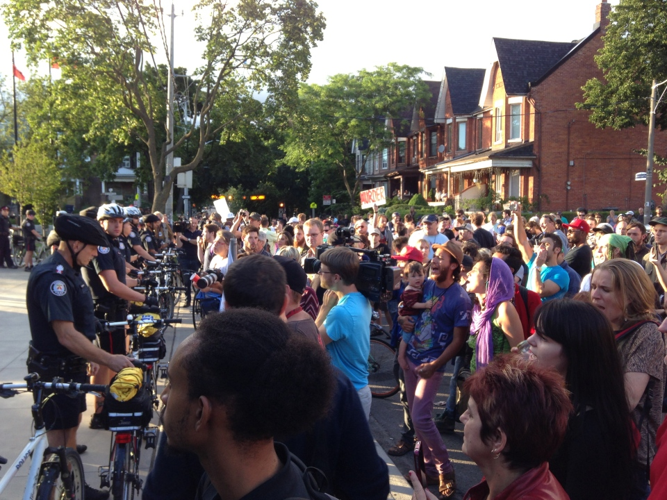 A crowd of protesters gathered outside 14 Division on July 29 to demand answers from police about a shooting that killed Sammy Yatin. (Brian Carr/CP24)