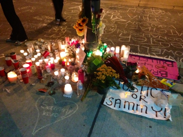 On July 29, 2013, messages, candles and flowers are left at the site of a deadly shooting that killed 18-year-old Sammy Matin. (Cristina Tenaglia/CP24)