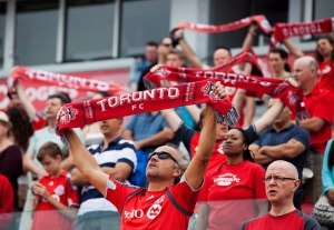 Toronto FC fans show their support as the national anthem is sung before the team takes on the Columbus Crew in MLS action in Toronto on Saturday, July 27, 2013. (The Canadian Press/Michelle Siu)