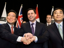 Mr. Sung Ha Chi, CFO of Samsung C&T Corporation, left, Brad Duguid, Minister of Energy and Infrastructure, centre, Dalton McGuinty, Premier of Ontario, back centre, and Mr. Chan-Ki Jung, Executive Vice President for KEPCO, right, pose for a photograph after signing an agreement that will bring more green energy to Ontario, on Thursday, Jan. 21, 2010 in Toronto. (THE CANADIAN PRESS/Nathan Denette)